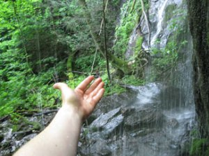 Hand in waterfall